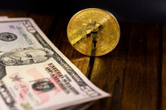 Bitcoin with dollars Royalty Free Stock Photography