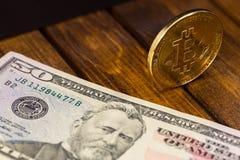 Bitcoin with dollars Royalty Free Stock Photos