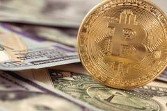 Bitcoin on dollars Stock Photo