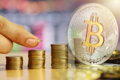 Bitcoin double exposure to stack gold coin of financial grown co. Ncept and on wooden floor for design presentations in your business royalty free stock photo