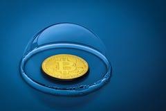Bitcoin in een zeepbel op een blauwe achtergrond stock foto's