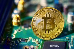 Bitcoin on electronic circuit board. Cryptography and Electronic. Money concept. Currency trading and Gold mining theme. Business and Technology theme royalty free stock image