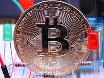 Bitcoin and electronic components stock photography
