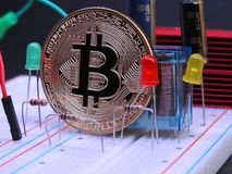 Bitcoin and electronic components Stock Photos
