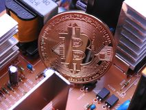 Bitcoin and electronic parts and aluminium coolers Stock Photo