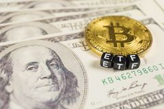 Bitcoin with ETF text on a dollar bills stock image