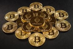 Bitcoin with ethereum coins in center. Ethereum in pyramid Royalty Free Stock Photography