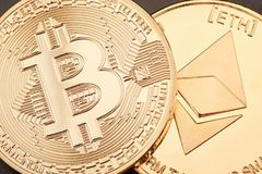 Bitcoin and Ethereum golden coins background Stock Image