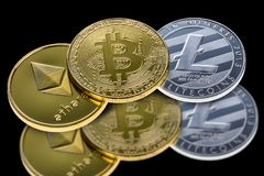 Bitcoin, ethereum and litecoin coins isolated on black background with reflection. Crypto currency electronic money for web bankin. G and international network royalty free stock image