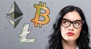 Bitcoin, Ethereum and Litecoin with young businesswoman. In a thoughtful face Royalty Free Stock Images