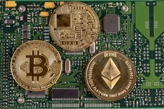 Bitcoin and Ethereum on the printed circuit board.Concept of cry Stock Photography