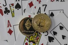 Bitcoin and etherium token with cards and dice. A bitcoin and etherium token with cards and dice royalty free stock photo