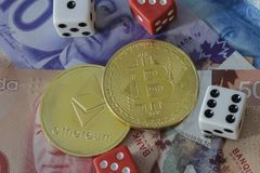 Bitcoin and etherium token with money and dice. A bitcoin and etherium token with money and dice stock photo