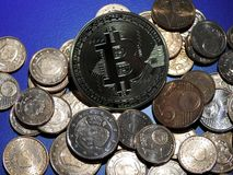 Bitcoin and Euro cents. Bitcoin on a pile of Euro cents stock images