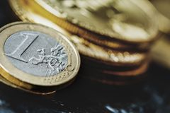 Bitcoin and Euro coin. Virtual currency Bitcoin and Euro coin on dark table Royalty Free Stock Photo