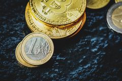 Bitcoin and Euro coin. Virtual currency Bitcoin and Euro coin on dark table Royalty Free Stock Image