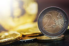 Bitcoin and Euro coin. Virtual currency Bitcoin and Euro coin on dark table Stock Photography