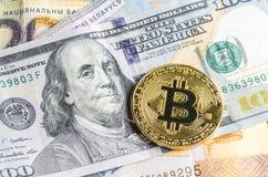 Bitcoin, euro et dollars Photographie stock