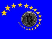 Bitcoin and Europe. A bitcoin with the European flag and the stars spiraling around it Royalty Free Stock Photo