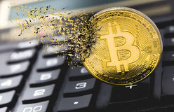 Bitcoin explosion and disintegration. Bitcoin explosion with a calculator Royalty Free Stock Photo