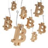 Bitcoin för många symboler av guld på fiske hakar Royaltyfria Bilder