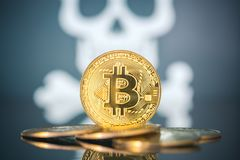 Bitcoin fail concept, Golden bitcoin with skull and bones in the background. Dark background royalty free stock photography