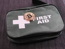 Bitcoin first aid bag Stock Photography