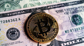 Bitcoin on five dollar banknote. Trading concept Royalty Free Stock Photos