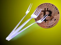 A bitcoin fork forked Royalty Free Stock Photo