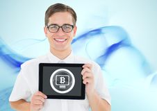 Bitcoin glass circle and man holding tablet royalty free stock photo