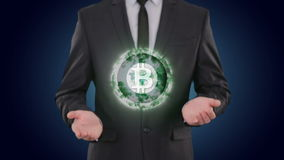 Bitcoin glowing energy in the hands businessman. concept Finance Currencies. Bitcoin in glowing energy ball in the hands of a businessman increases in volume stock video footage