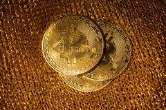 Bitcoin on a gold background royalty free stock photo