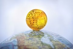 bitcoin with gold bitcoin symbol and Earth symbol Royalty Free Stock Images