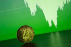 Bitcoin gold coin on the background of the graph. Of the monitor. Business concept Stock Photos