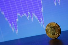 Bitcoin gold coin on the background of the graph. Of the monitor. Business concept Stock Photo