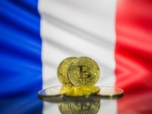 Bitcoin gold coin and defocused flag of France background. Virtual cryptocurrency concept. royalty free stock photo