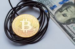 Bitcoin gold coin and network wire connectors patch cord cable. Concept of digital money transfer stock photography