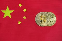 Bitcoin on the Background Chinese Flag stock photography
