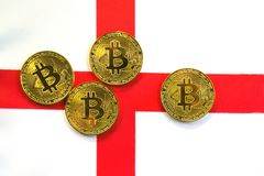 Bitcoin Gold Color on the Flag of England. Cryptocurrency on Background of English Flag Stock Photo