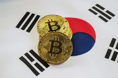 Bitcoin on the Background South Korea Flag. Bitcoin Gold Color on the Flag of South Korea royalty free stock photography