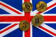 Bitcoin Gold Color on the Flag of United Kingdom. Cryptocurrency on Background of Union Jack Flag Royalty Free Stock Image