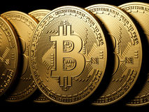 Bitcoin gold isolation on black Royalty Free Stock Images
