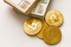 Bitcoin gold and the Russian ruble. Bitcoin coin on the background of Russian rubles. royalty free stock photo