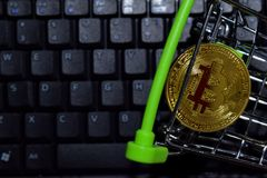 Bitcoin gold in Shopping cart on keyboard laptop background. Trade and business concept. N royalty free stock photo