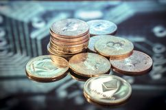 Bitcoin gold, silver and copper coins and defocused printed circ stock photos