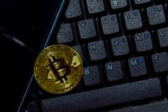 Bitcoin gold and smartphone on keyboard laptop background. Trade and business concept stock photography