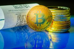Bitcoin golden coins and paper receipt. Macro Stock Image