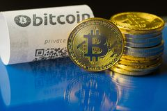 Bitcoin golden coins and paper receipt. Macro Stock Images