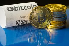 Bitcoin golden coins and paper receipt. Macro Royalty Free Stock Photography