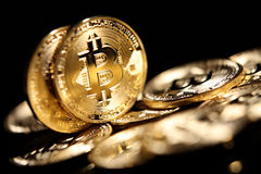 Bitcoin. Golden Bitcoin digital currency, financial industry, Black background Stock Photo